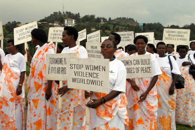 Women march for an end to violence in the DRC