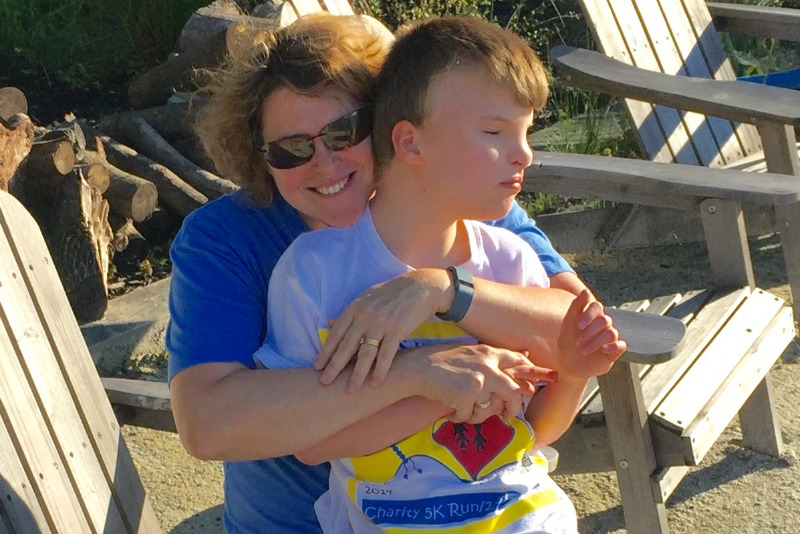 A recent photo of Women for Women International CEO, Jennifer L. Windsor at the beach with her 10-year-old son Jackson.