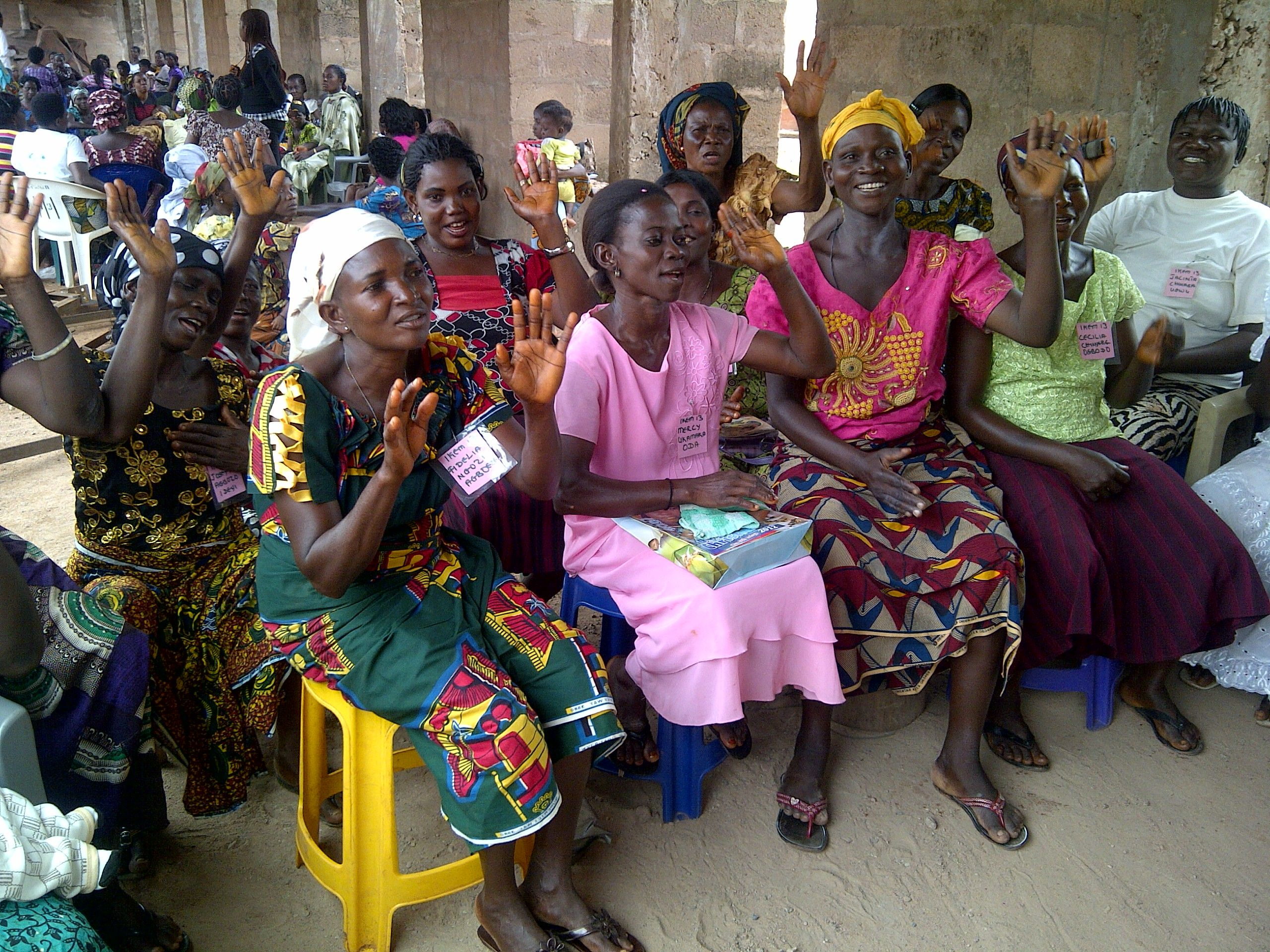 Participants gather together in a Women for Women training center