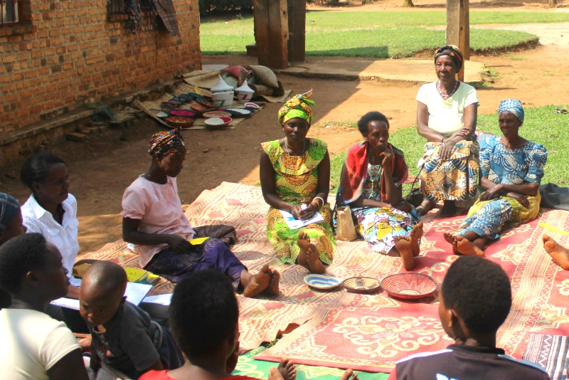 Program graduates in Rwanda come together to form a Village Savings and Loan Association