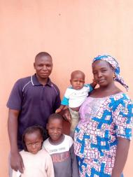 Saratu, a participant in Nigeria, and her family