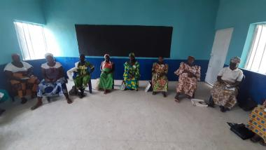Saratu and her group practice social distancing during a COVID-19 awareness session
