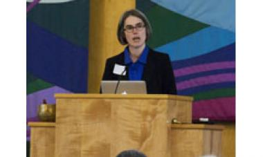 Deborah Bassett speaks at event about Women for Women International