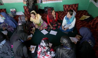 Afghan women attend their numeracy classroom conducted by Women for Women International in Deh Khodaidad area of Kabul