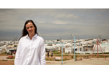 Brita Fernandez Schmidt in front of the Khanke camps for internally displaced people. Photo credit: Aidan O'Neill