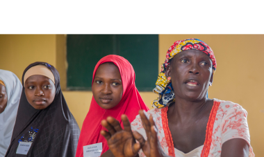 A class of 25 women from both Fulani herder and Christian farmer communities learning together in the Women for Women International year-long training program. Photo: Monilekan