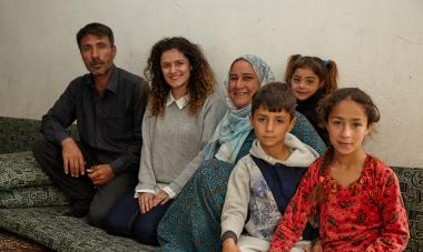 Shan with a participant and family in Iraq. Photo credit: Aidan O'Neill
