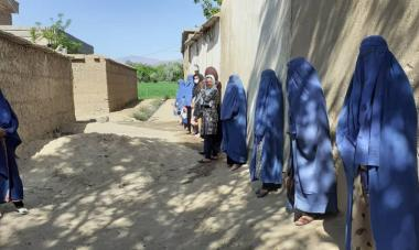 Photograph of women receiving hygiene kits in Afghanistan