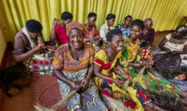 women in colorful dresses sitting and talking