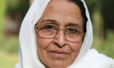 up close of woman in white headscarf