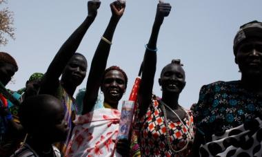 women smiling with fist in the air