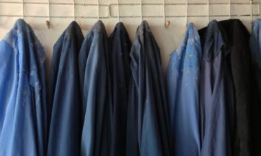 burkas hanging up on a wall