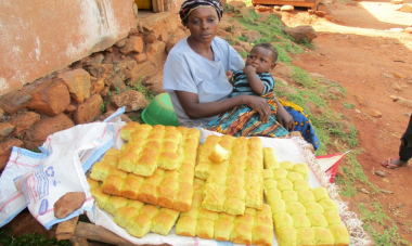woman with baby selling bread rolls