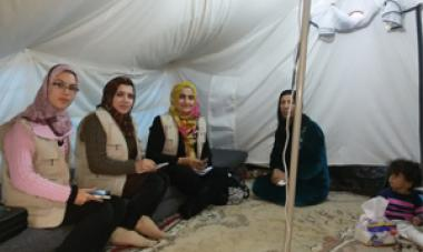 women in scarves sitting in tent