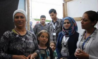 picture of women, children and men in Syria