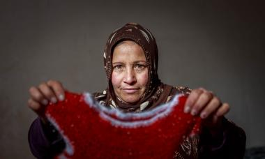 Iraq woman with woven dress