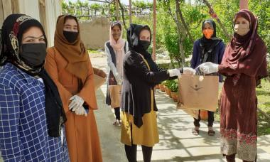 A group of women stands in wait for their hygiene kits in Afghanistan