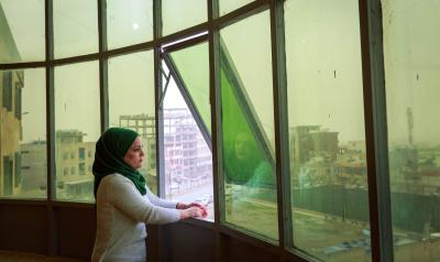 KRI - woman looking out of window