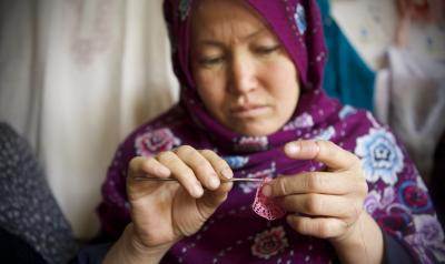 RS15615_Z38A9573.The Friends of Rights Association.Sakina, 25, mother of 3, crocheting-scr.jpg