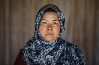 Afghan woman looking into the camera