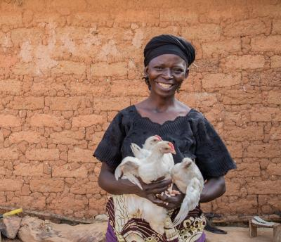 Nigeria woman with chickens