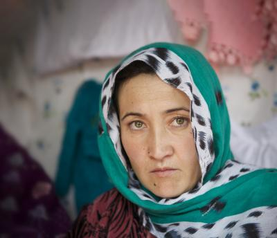 Emotive woman in green headscarf from Kabul, Afghanistan