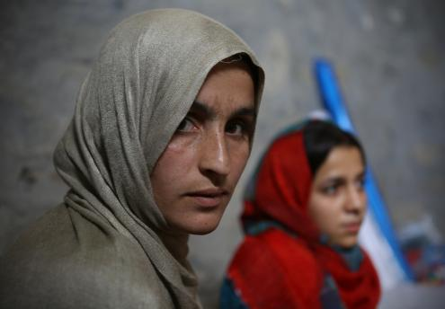 Participant in Afghanistan looks into camera